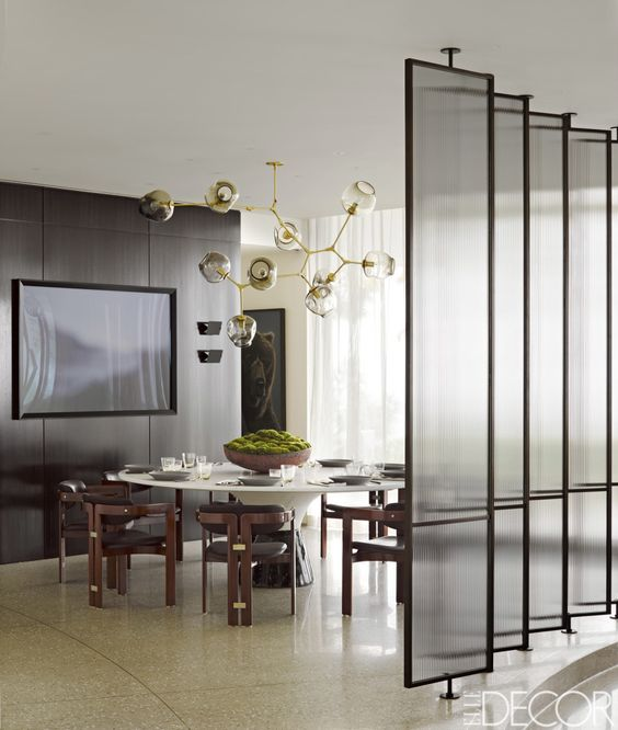 narrow framed glass screens add to the decor and separate areas without looking too bulky