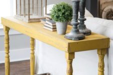 12 a distressed yellow onsole table will stand out in a grey living room