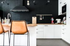 12 in this kitchen only walls and a backsplash are black, it makes the kitchen more airy and inviting
