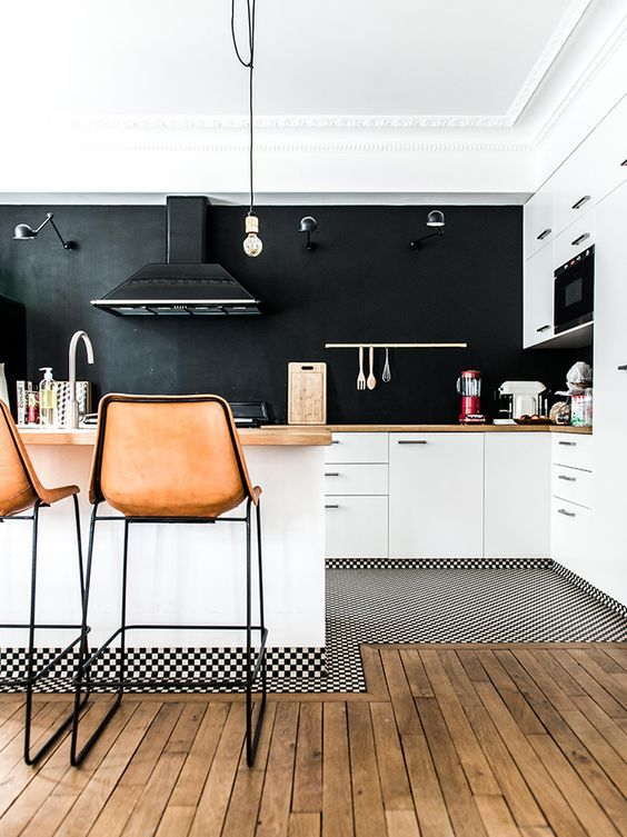 in this kitchen only walls and a backsplash are black, it makes the kitchen more airy and inviting