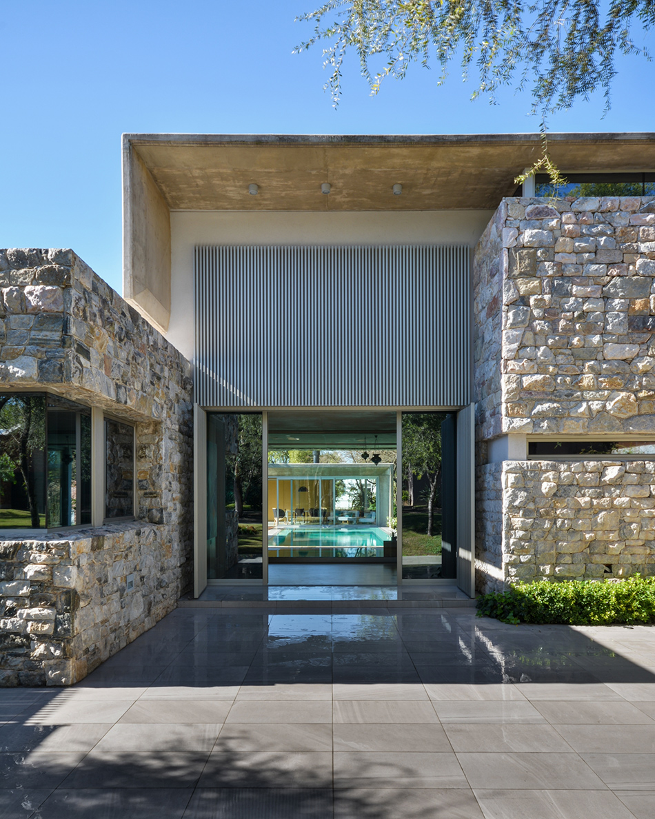 modern entrance clad with natural stone and sleek tiles for a contrast