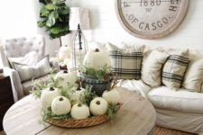 12 neutral decor with pumkins and greenery will bring a fall feel to the space