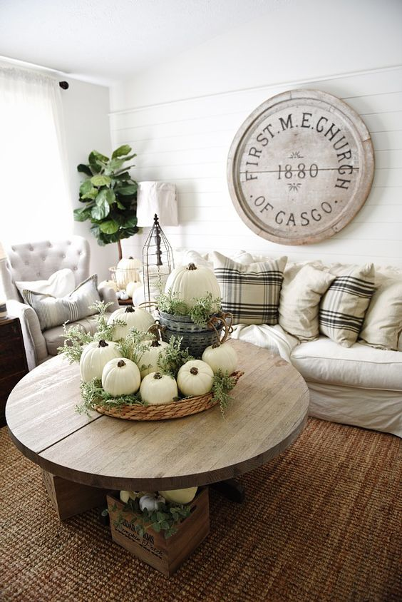 neutral decor with pumkins and greenery will bring a fall feel to the space