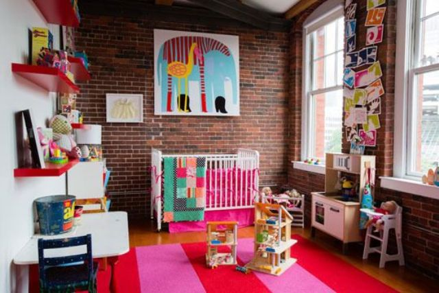 red brick walls look bright and blend perfecctly with this colorful nursery design