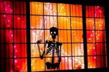12 skeleton silhouette in the window