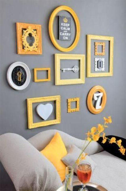 a grey gallery wall bold yellow frames