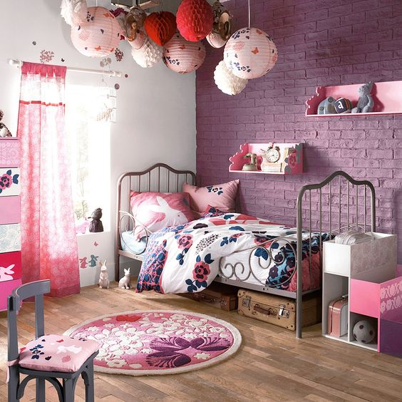 a pink exposed brick wall is an original take on traditional brick walls