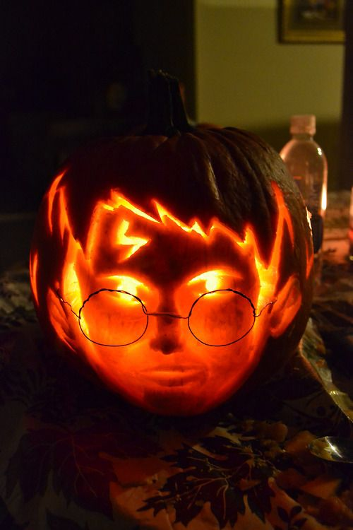awesome carved Harry Potter pumpkin and lantern looks like a live head