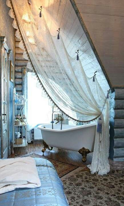 bathtubs in attic bedrooms are a hot trend, and a tulle curtain can easily divide these two spaces