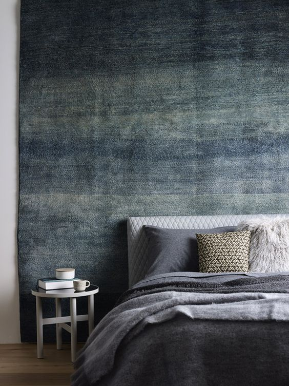 Hanging A Floor Rug On The Walls Allows To Create Eye Catchy And Mobile Decor