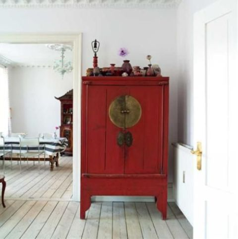 heirloom Asian antique cabinet blends in a whitewashed space