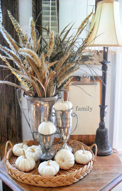 neutral pumpkins and spikelets in vintage cups