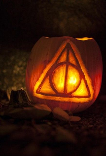 Deathly Hallows symbol from the Harry Potter series carved on a pumpkin