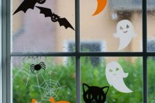 14 adorable Halloween window clings featuring happy pumpkins, laughing ghosts and pretty cats