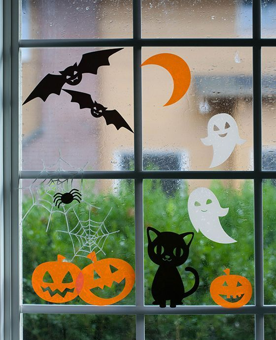 adorable Halloween window clings featuring happy pumpkins, laughing ghosts and pretty cats