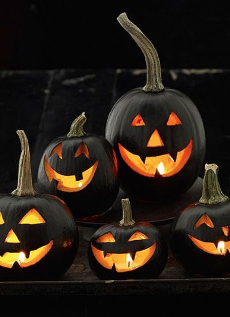 black jack-o-lanterns for decorating outdoors are a stylish ensemble