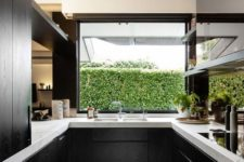 14 black wooden cabinets look great with white marble tops and make a perfect modern kitchen
