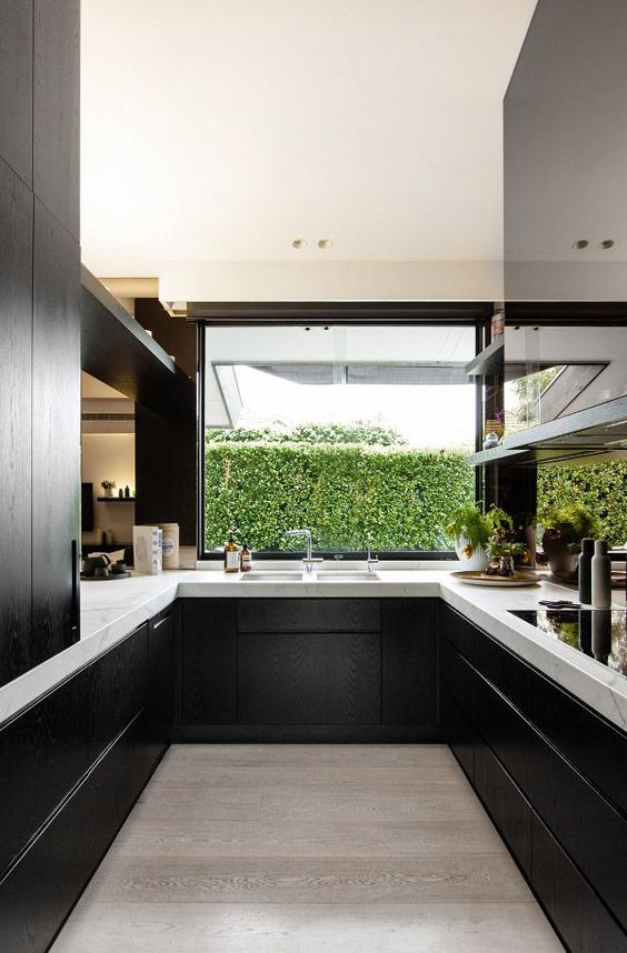 black wooden cabinets look great with white marble tops and make a perfect modern kitchen