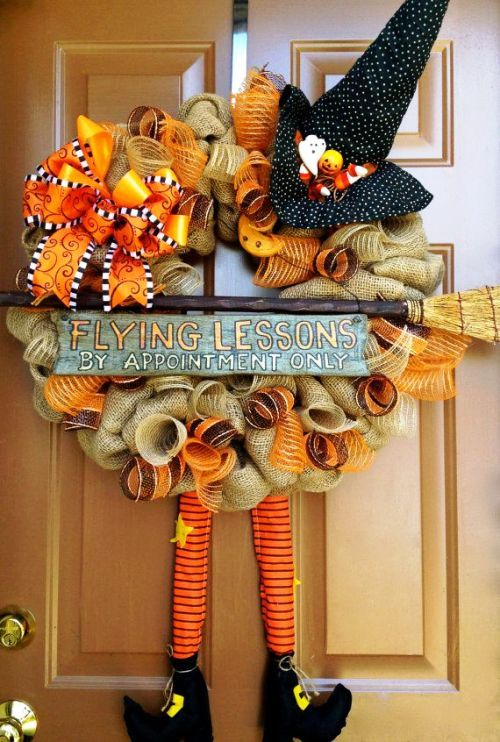 burlap Halloween wreath with a flying lessons announcement is a fun idea