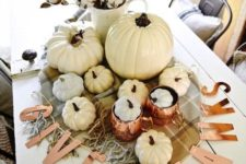 14 pops of copper and neutral pumpkins mixed with plaid and cotton make a lovely centerpiece