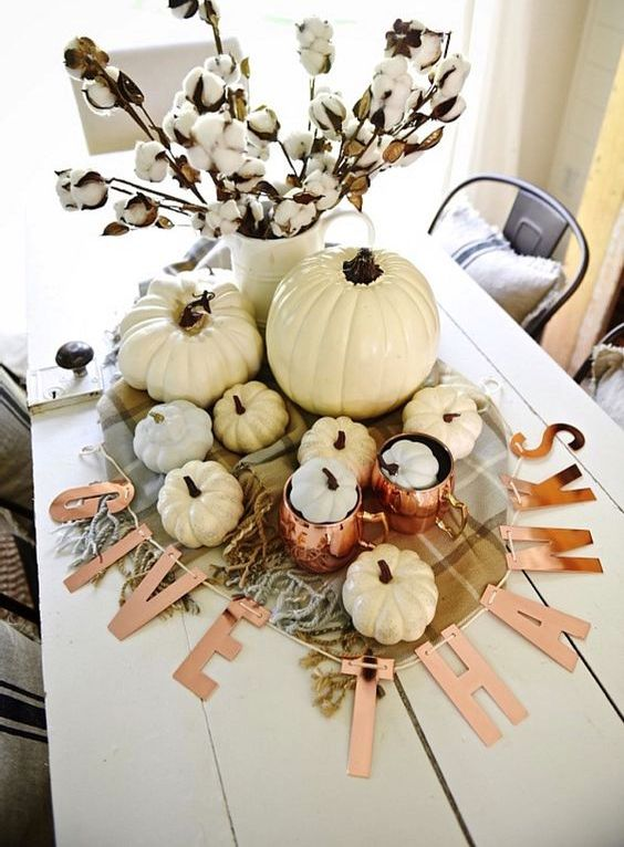 pops of copper and neutral pumpkins mixed with plaid and cotton make a lovely centerpiece