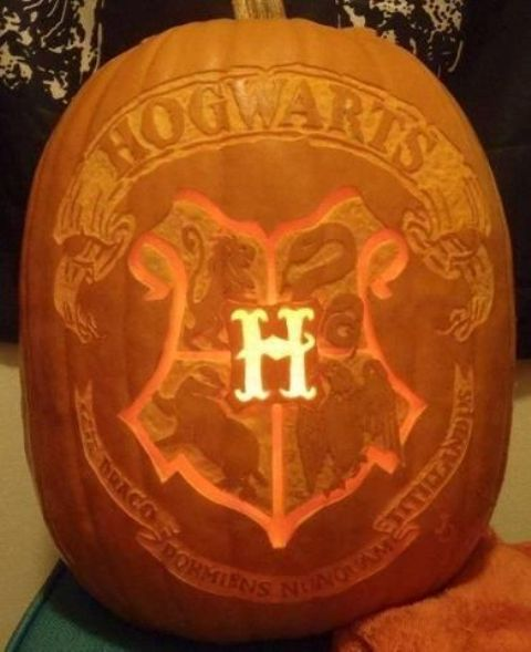 Hogwarts pumpkin carved and working as a lantern