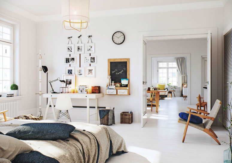 The home office nook is all-white with photos and a chalkboard with storage