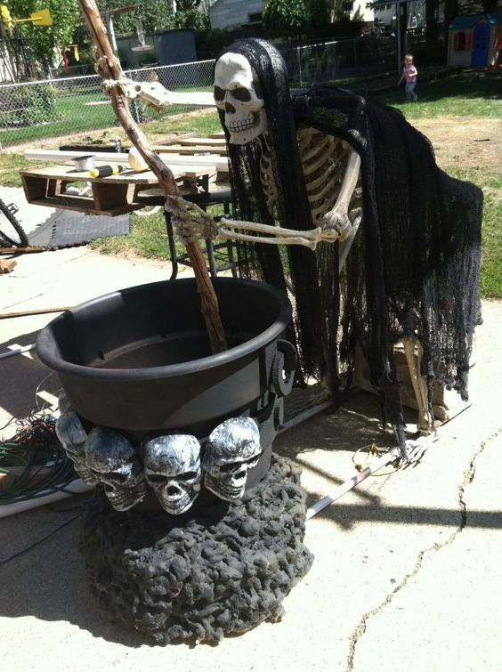 skeleton stirring something in a cauldron can be placed at your front porch or in the backyard
