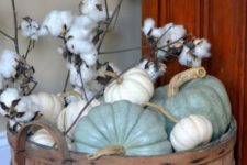 15 spray painted neutral pumpkins and cotton in a vintage wooden bucket