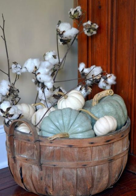 spray painted neutral pumpkins and cotton in a vintage wooden bucket