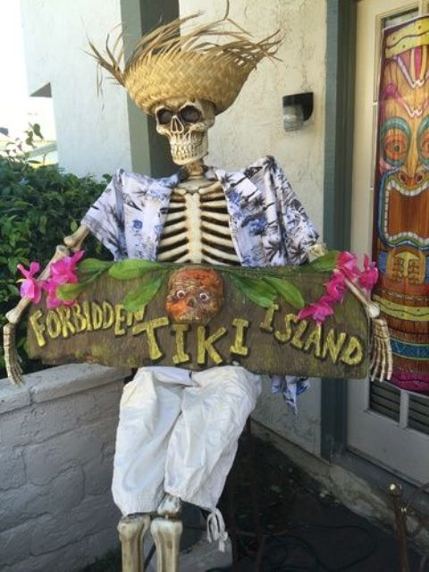 tropically dressed skeleton with a sign