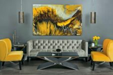 16 refined living room in grey shades looks bolder with yellow chairs and a painting