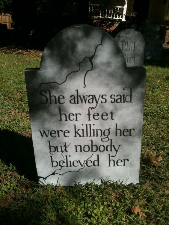 tombstones on bottom cabinet doors, each one with a funny name and epitaph