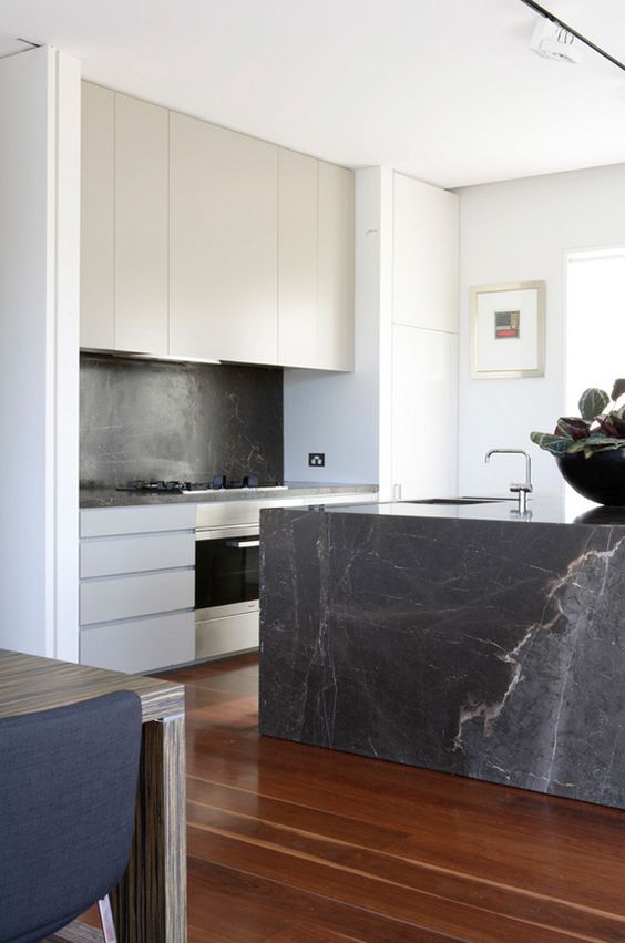 black soapstone spruces up this seemingly simple modern kitchen