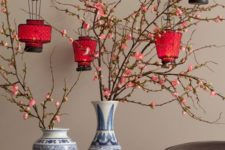 17 cherry-blossom branches with red paper lanterns