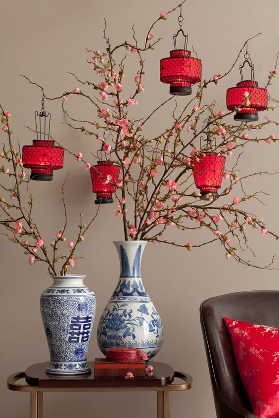 cherry-blossom branches with red paper lanterns
