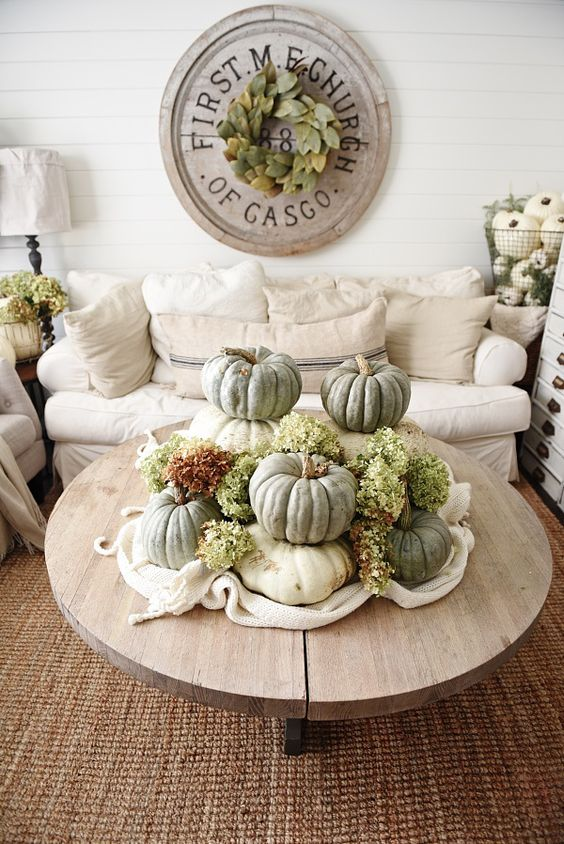 heirloom pumpkins in shades of green and slik flowers