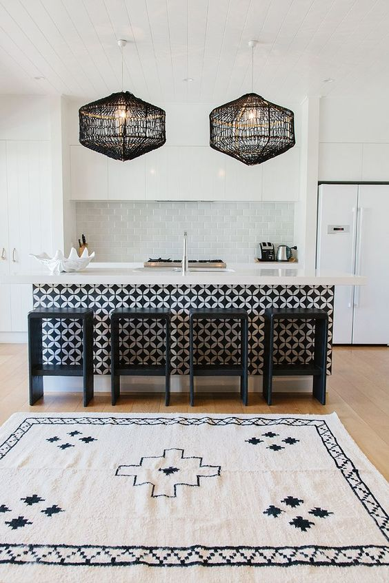 play with colors and textures like here   a patterned kitchen island and crochet lampshades