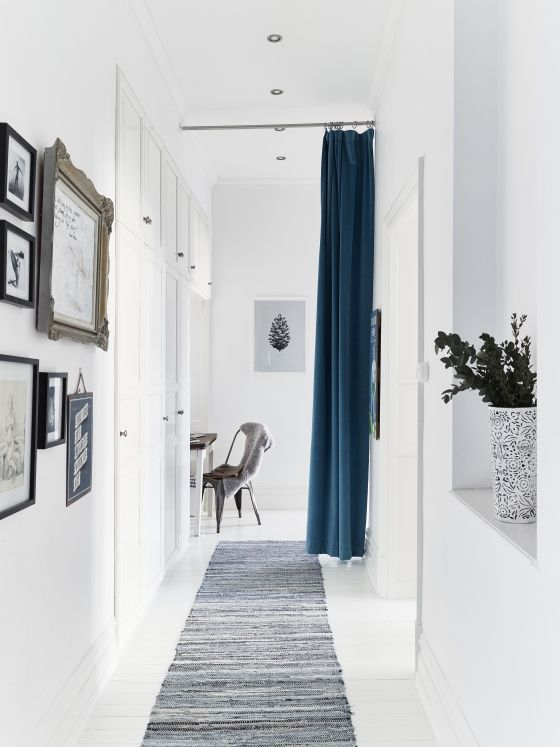 this blue curtain is used instead of a door to separate the dining room from the hallway