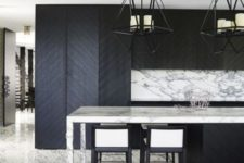 18 marble and chevron clad wood make this kitchen eye-catchy and interesting