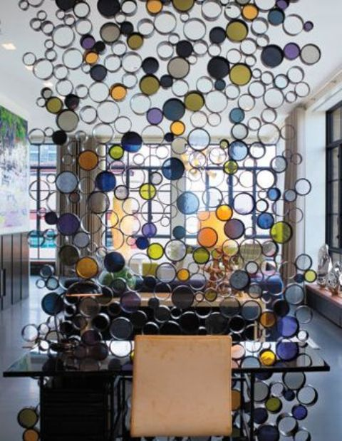 colorful glass room divider creates a fun and cheerful touch to the decor of the space