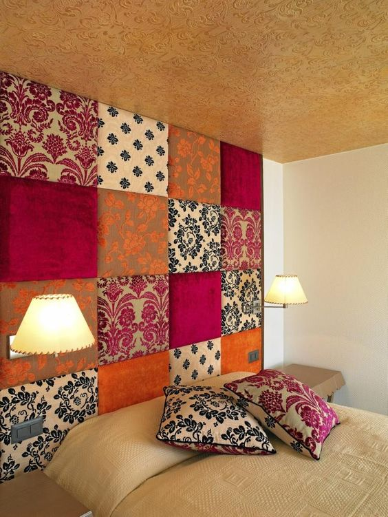 patchwork upholstered accent wall doubles as a headboard