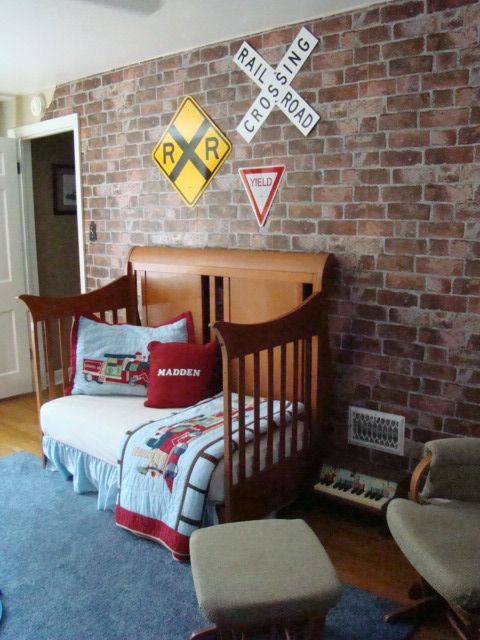 train-inspired boy's room looks great with an exposed brick wall