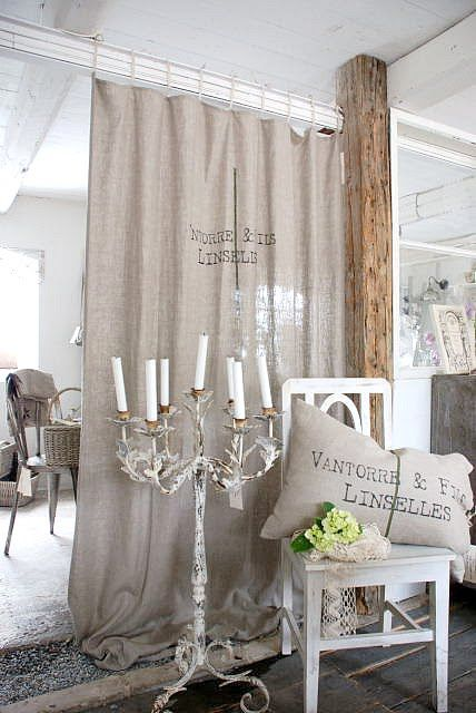 vintage burlap curtain adds to the shabby chic room decor