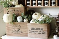 19 vintage crates with white pumpkins and greenery