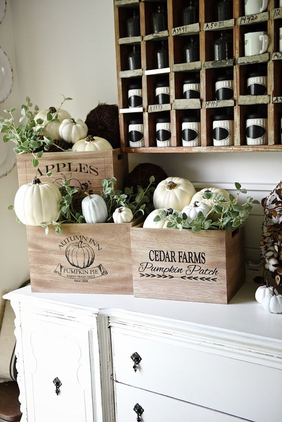 vintage crates with white pumpkins and greenery