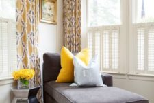 20 a charcoal couch and a bold yellow pillow look very contrasting