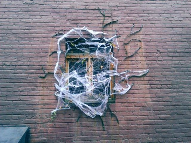 give your home a ghoulish look with faux spiderweb, branches and spiders