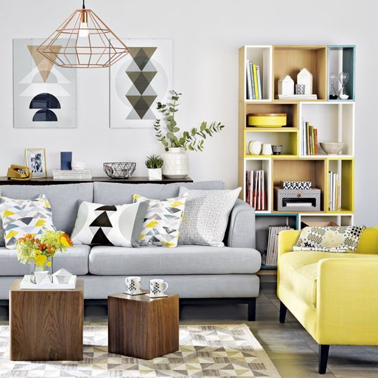 A Light Grey Sofa With Bright Yellow Chair In The Same Style