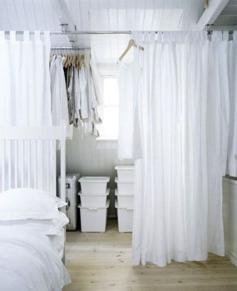a sheer curtain may easily hide a closet space and make your sleeping zone more private